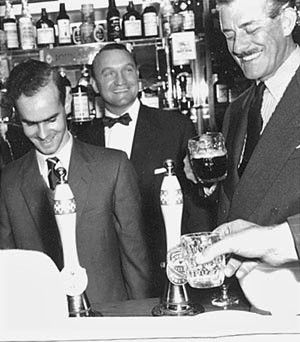Leslie Mitchell, Wally Pack, and Malcolm Baird at the opening of the John Baird pub, 1959