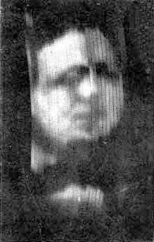 A photograph of Oliver Hutchinson taken from the screen of Baird's Televisor in 1926
