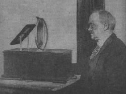 Charles Francis Jenkins looking into the lens of his Radiovisor