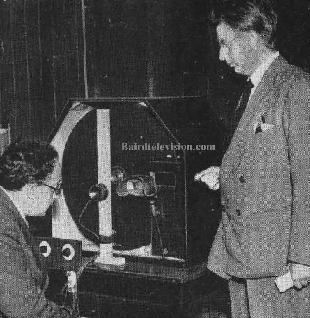 Baird demonstrating his stereoscopic receiver